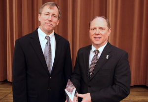 Charles Cascio (right) receives the Distinguished Fellow Award
